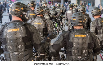 Seattle, Washington USA May 1st 2018 The annual May Day protests held downtown, police officers on bicycles from behind wearing combat armor and helmets.