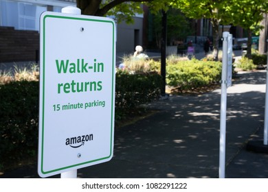 "Seattle, Washington/ USA - May 2, 2018: Side view on a ""Walk-In Returns 15 Minute Parking"" sign, for taking back online orders at an Amazon Fresh Pick Up store"