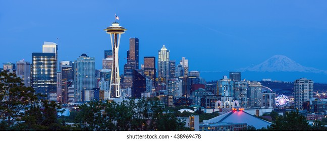 Seattle, Washington, USA - May 30, 2016: A panoramic dusk view of a clear spring evening at Seattle Downtown, with Mount Rainier in the background.