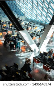 Seattle, Washington / USA - May 7 2019: People work in the upper atrium of the Seattle Public Library, with iconic geometric beams designed by architect, Rem Koolhaas