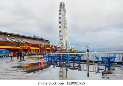 Seattle Washington USA - November 1, 2018: Seattle Great Wheel on a raining day. The Seattle Great Wheel is a giant Ferris wheel at Pier 57 on Elliott Bay in Seattle, Washington.
