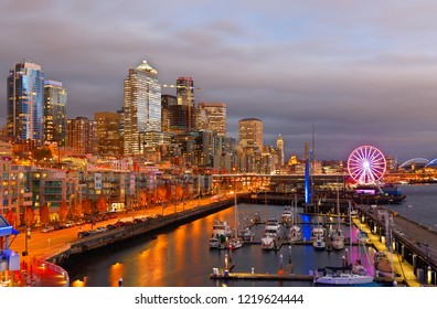 Seattle Washington, USA - November 2, 2018: Seattle Skyline Showing the waterfront of Seattle After Sunset. The Central Waterfront of Seattle, is the most urbanized portion of  Elliott Bay shore.