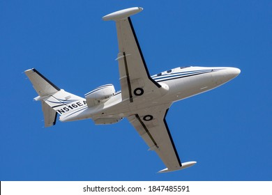 SEATTLE, WASHINGTON / USA - October 30, 2020: An Eclipse 500 departs from Boeing Field on a sunny day in Seattle.