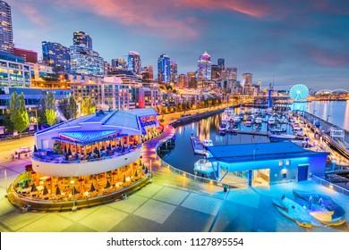 Seattle, Washington, USA pier and skyline at dusk.