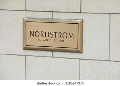 Seattle, Washington /USA - September 15 2018: Close up on a bronze name plate for Nordstroms Established 1901, outside of the flagship department store and corporate headquarters