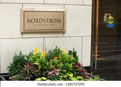 Seattle, Washington /USA - September 15 2018:  Bronze name plate for Nordstroms Established 1901, outside of the flagship department store and corporate headquarters