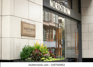 Seattle, Washington /USA - September 15 2018:  Side view on a bronze name plate for Nordstroms Established 1901, outside of the flagship department store and corporate headquarters