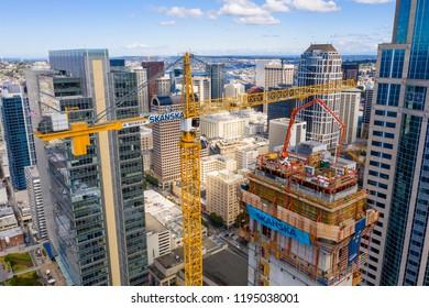 SEATTLE, WASHINGTON, USA - SEPTEMBER 15, 2018: Aerial drone image of Skanska cranes in Seattle