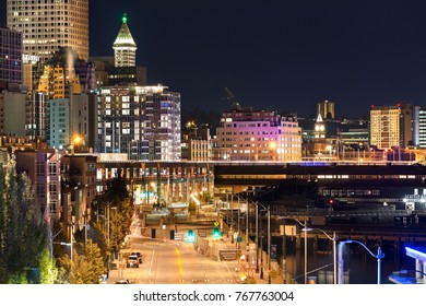 Seattle, Washington, USA - September 3th, 2017: Night view of the Alaskan way at the Seattle Aquarium entrance and the Observation deck of the Smith Tower at the background.