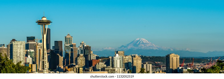 Seattle, Washington - USA. Wide panorama of sunset above Space Needle, with Mount Reinier in the background.
