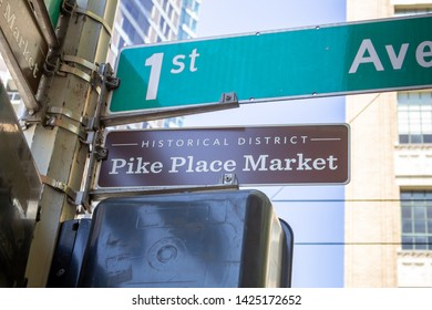 Seattle, Washington/United States - 04/29/2019: An intersection post featuring signs for 1st Avenue and Pike Place Market Historic District