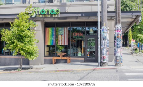 Seattle, Washington/United States – 05/07/2019: This is a view of the exterior of Manao, a Thai street food restaurant. Rainbow flags are popular and seen in stores and houses all over Seattle.