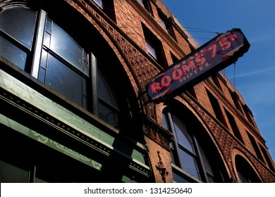 Seattle, Washington/United States - 5/12/16: A 75 cent hotel sign hanging outside a building in the historic district of Seattle