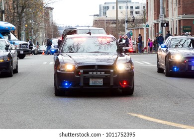 Seattle, Washington/USA - January 20, 2018: Woman March. Police vehicles bring up the end of the protest.