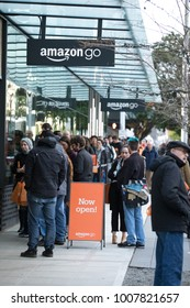 SEATTLE, WASHINGTON/USA - January 22, 2018:  Customers waiting along 7th avenue to enter the Amazon Go store, with a Now Open sign on the sidewalk, at the downtown Seattle Amazon headquarters