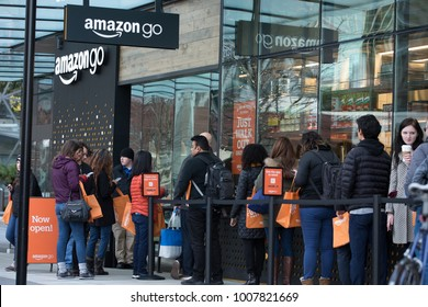 SEATTLE, WASHINGTON/USA - January 22, 2018: Line of people waiting to enter the Amazon Go store, during opening day, at the downtown Seattle Amazon headquarters