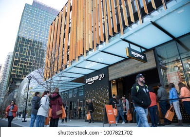 SEATTLE, WASHINGTON/USA - January 22, 2018:  Wide angle view of customers waiting to enter the Amazon Go store at the Seattle Amazon headquarters, with glass sphere building in the background