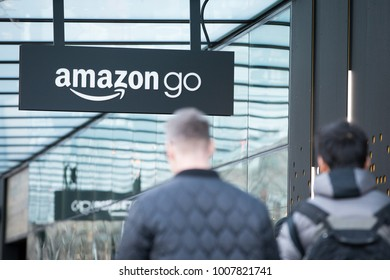 SEATTLE, WASHINGTON/USA - January 22, 2018: Amazon Go store sign and logo, at the downtown Seattle Amazon headquarters, with two men in the foreground