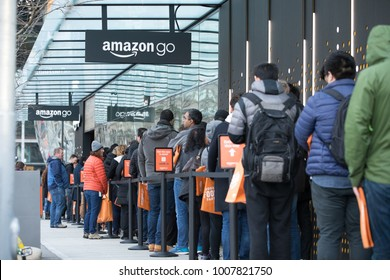 SEATTLE, WASHINGTON/USA - January 22, 2018: Line of people waiting to enter the Amazon Go store, during the grand opening, at the downtown Seattle Amazon headquarters