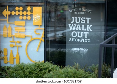 SEATTLE, WASHINGTON/USA - January 22, 2018: Window sign outside of the Amazon Go store, at the downtown Seattle headquarters, with slogan 'Just Walk Out'
