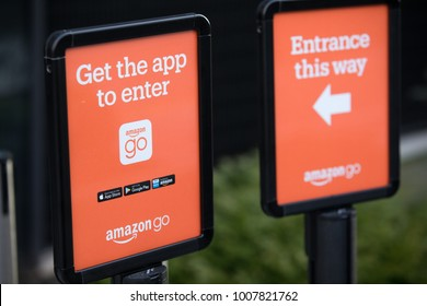 SEATTLE, WASHINGTON/USA - January 22, 2018: Side view on signage outside of the Amazon Go store at the downtown Seattle headquarters, with instruction to download the mobile app, beside entrance arrow