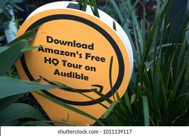 "SEATTLE, WASHINGTON/USA - January 22, 2018: Close up on ""Download Amazon's Free HQ Tour on Audible"" sign outside of Amazon's headquarters in downtown Seattle"