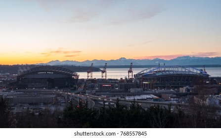 SEATTLE, WASHINGTON/USA - JANUARY 6, 2017: SODO Cityscape South Downtown Stadiums Century Link Field Safeco Field Sunset Olympic Mountains Background