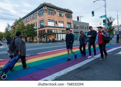 SEATTLE, WASHINGTON/USA - JUNE, 2017: Pedestrians Cross the Street on a Rainbow Crosswalk on Capitol Hill at the Corner of East Pike St and Broadway