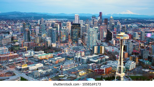 Seattle, Washington/USA - March 12, 2018: Seattle Space Needle Under Remodeling Construction with Seattle Skyline and Mt Rainer Background Aerial Panorama Shot From Helicopter