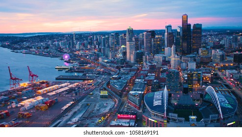 Seattle, Washington/USA - March 12, 2018: Aerial View From Port of Seattle Shipping Yard Century Link Field Looking North Along Waterfront Spectacular Orange Sun Lighting Skyline