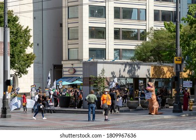 SEATTLE, WASHINGTON/USA - Sep 5, 2020: People demonstrate in Westlake Park in the heart of the Seattle downtown shopping district. Many different posters communicate their wishes and beliefs.