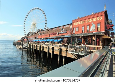 Seattle, Washington/USA - September 14, 2017, A Seattle waterfront restaurant with the iconic Great Wheel in the background.