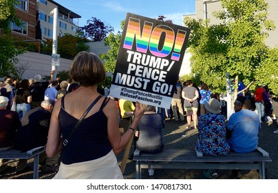 SEATTLE, WASHINGTON/USA-JULY 12, 2019: Activists attend a Lights for Liberty candlelight vigil to protest Trump's detention camps.