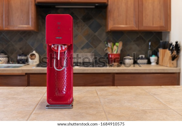Seattle, WA,USA - March 4, 2020: Red Sodastream on Countertop with Kitchen Scene in Background