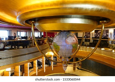 Seattle, WA/USA-9/13/19: The curve lines of the ceiling with a ornamental globe giving a cruise ship a luxurious feel.