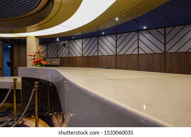 Seattle, WA/USA-9/13/19: The curve lines of the guest services desk on a cruise ship with no people.