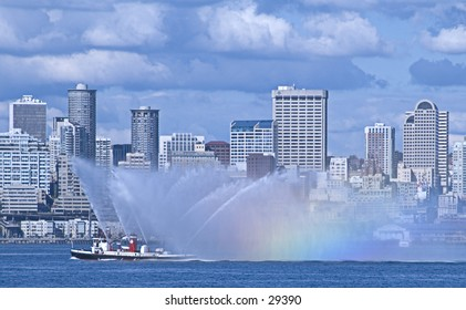 Seattle's fireboat sprays water, creating a rainbow