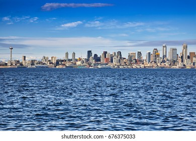 Seattle's waterfront skyline full of construction cranes as the city grows