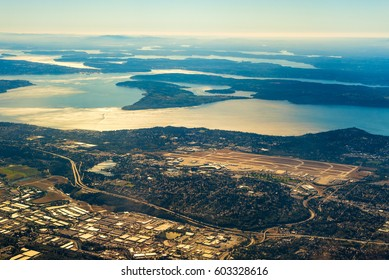 Seattle-Tacoma International Airport from the air with the southern end of Puget Sound in late afternoon light