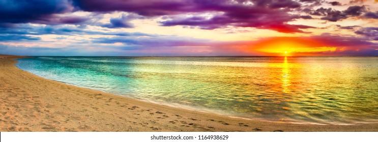 Seaview at sunset. Amazing landscape. Beautiful beach of Mauritius. Panorama