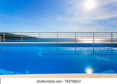 Seaview swimmin pool in a modern mediterranian villa . afternoon. without people