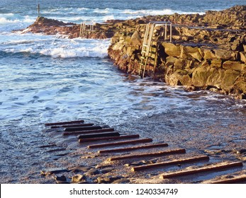 Seawater swimming pool in Tenerife. Section of an inlet for fishing boats into the sea and a staircase leading from a rock directly into the Atlantic Ocean.