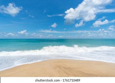 Seawater wave splash on sandy beach.