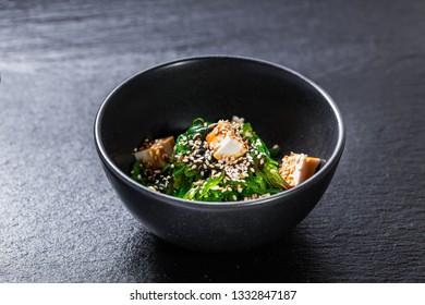 Seaweed salad with tofu and unagi sauce
