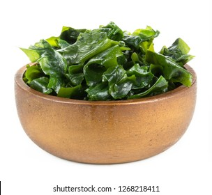 Seaweed in wooden bowl Isolated on White Background