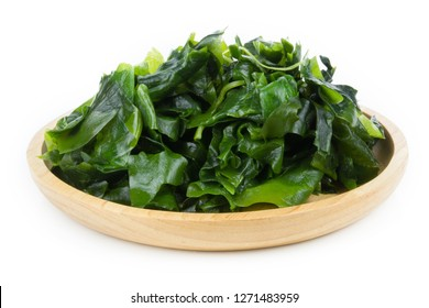 Seaweed in wooden dish Isolated on White Background