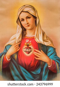 SEBECHLEBY, SLOVAKIA - JANUARY 6, 2015: The Heart of Virgin Mary. Typical catholic image (in my own home) printed in Germany from the end of 19. cent. originally by unknown painter.