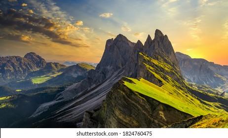 Seceda peak Italy, Trentino Alto Adige, Dolomites Alps, South Tyrol, Italy, Europe. Odle mountain range, Val Gardena, Majestic Furchetta peak, Italian dolomites, Italy