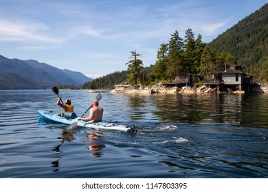 Sechelt Inlet, Sunshine Coast, British Columbia, Canada - July 21, 2018: People kayaking during a vibrant sunny summer day.