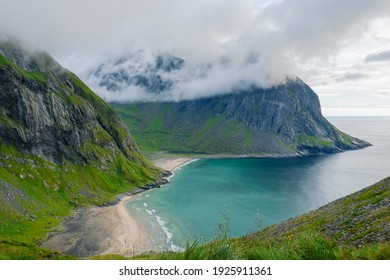 A secluded beach in the middle of a fjord caught in the clouds
